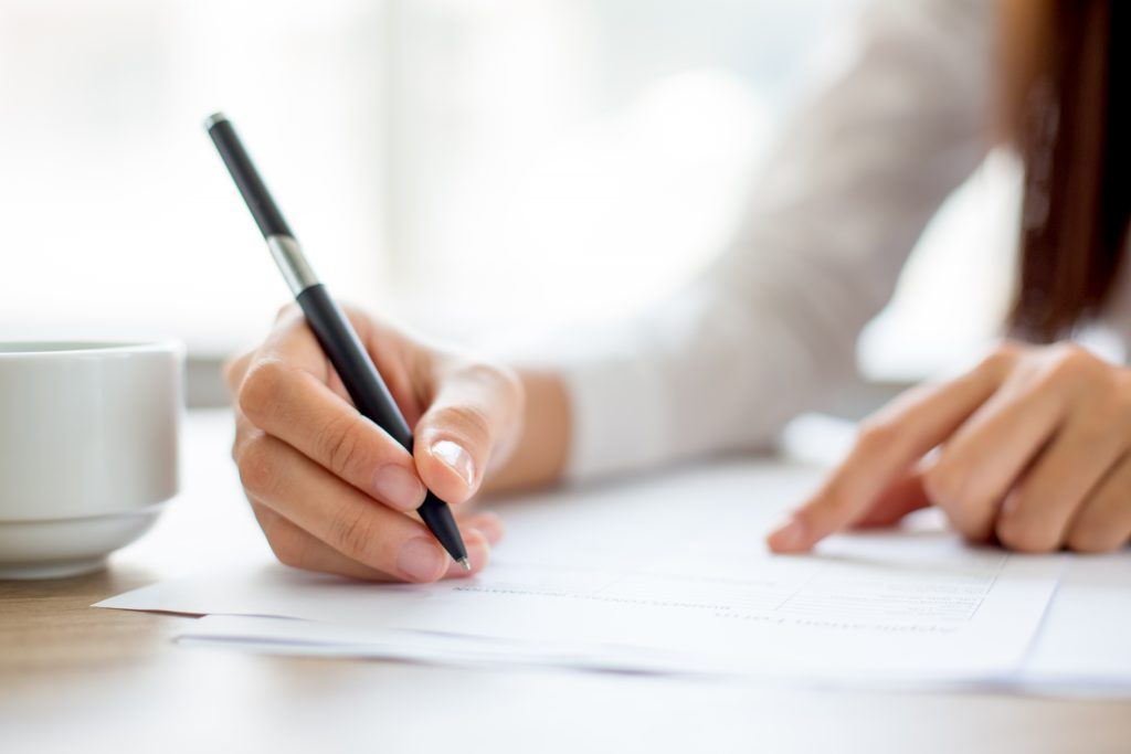 Hand of woman signing a contract