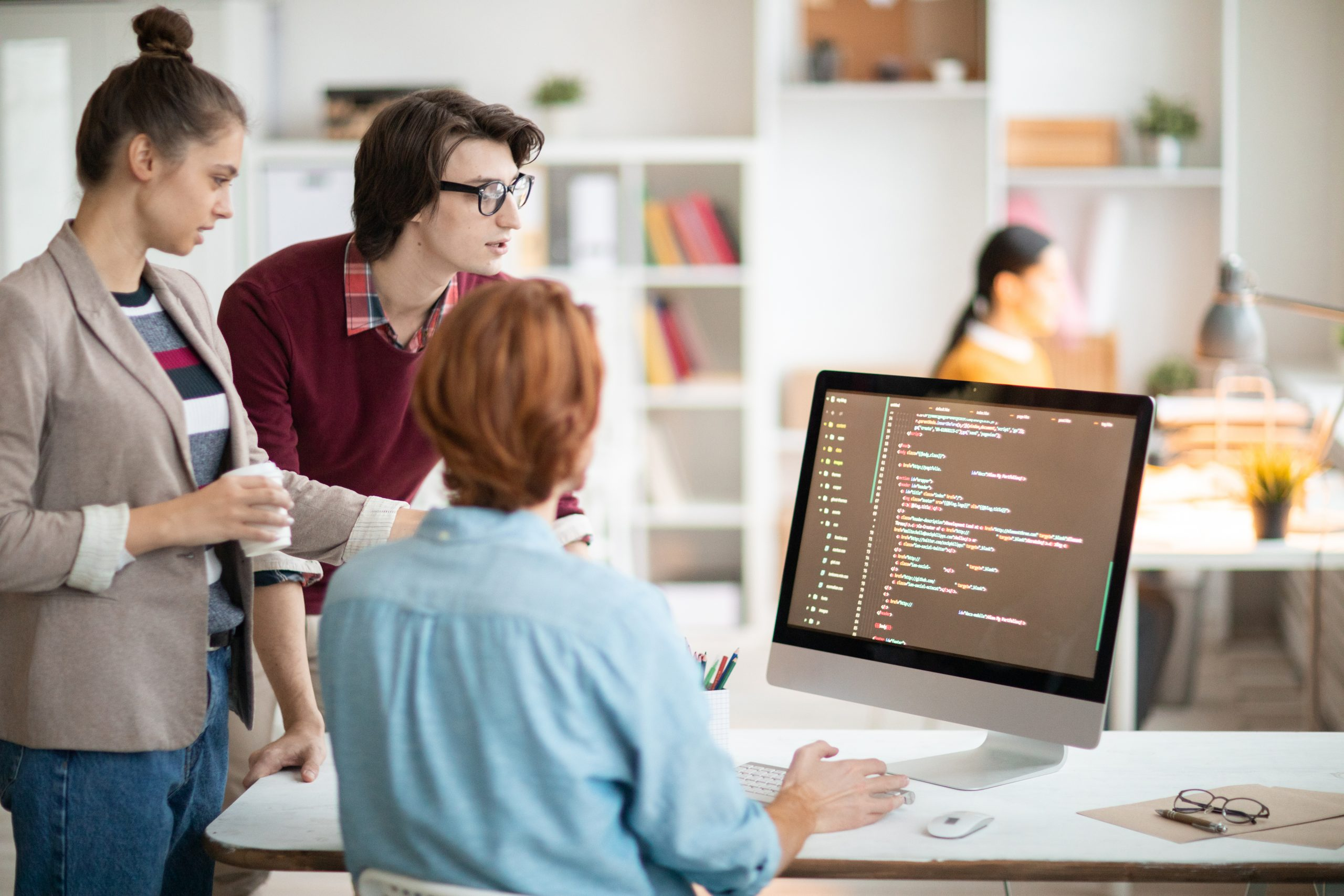 young programmers looking at screen managed it services